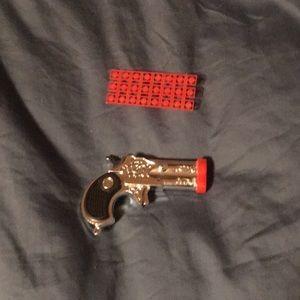 Small cap gun